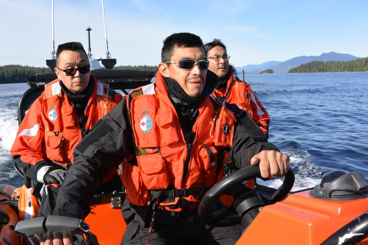 Numuch Keitlah, left, and Jake Thomas, centre, participate in a Coastal Nations search and rescue exercise off the coast of Vancouver Island in this undated handout photo. The recently operational Coastal Nations Coast Guard Auxiliary has more than 50 members from five Indigenous territories who are trained in marine search and rescue. They are on call day and night to respond to emergencies along some of B.C.'s most rugged and remote coastal areas.