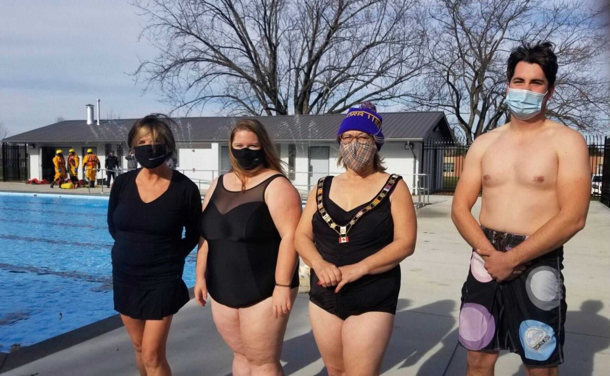Middlesex County Warden Cathy Burghardt-Jesson, Deputy Mayor Kelly Elliott, Thames Centre Mayor Alison Warwick, and Coun. Tom Heeman prepare to jump into the newly renovated Dorchester community pool to raise money for the Thames Centre Food Bank on Thursday, Nov. 19, 2020.