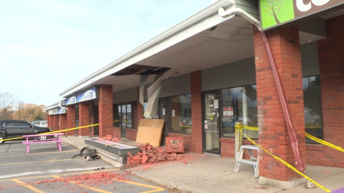 Kingston police are investigating what caused a vehicle to crash into a building early Friday morning.