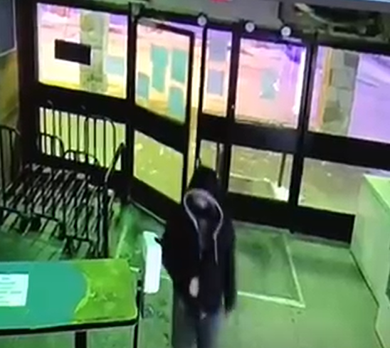 The second suspect, as seen on surveillance video.