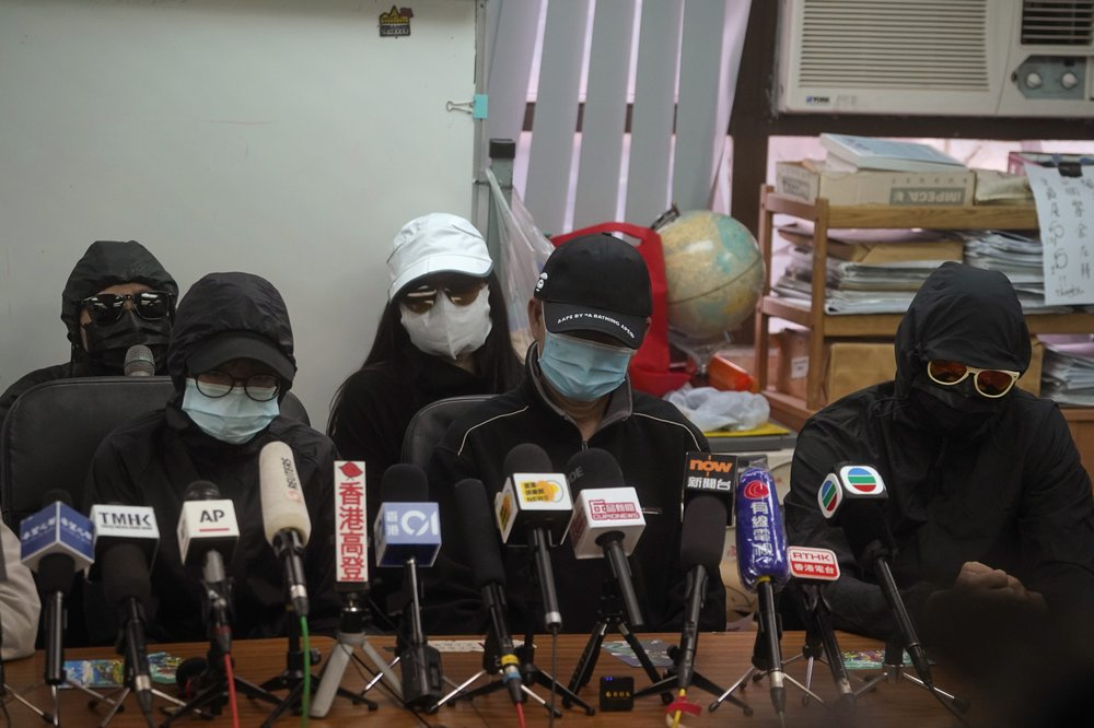 Relatives of a dozen Hong Kong residents who have been detained in mainland China attend a press conference in Hong Kong, Saturday, Dec. 12, 2020. The relatives made a plea Saturday to be informed of the timing of any trials and whether they could attend.
