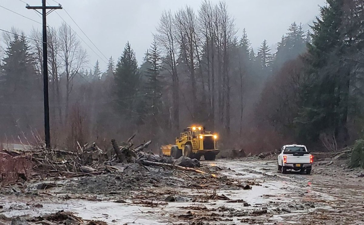 Crews with the Alaska Department of Transportation & Public Facilities work to clear debris from a mudslide in Haines, Alaska on Dec. 2, 2020.