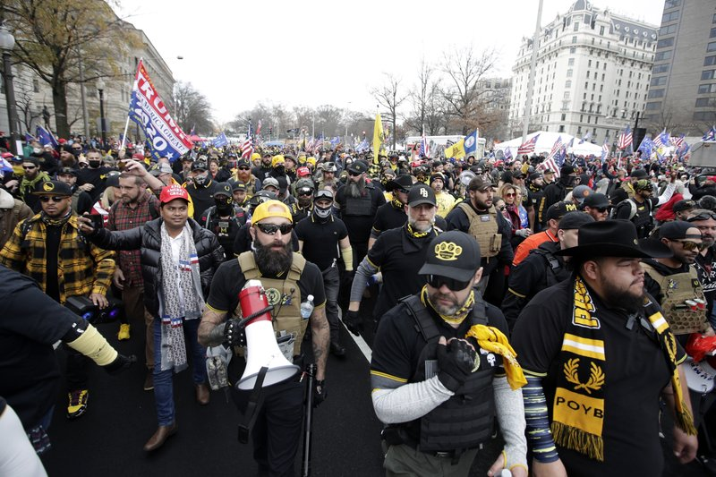 Supporters of President Donald Trump who are wearing attire associated with the Proud Boys attend a rally at Freedom Plaza, Saturday, Dec. 12, 2020, in Washington.