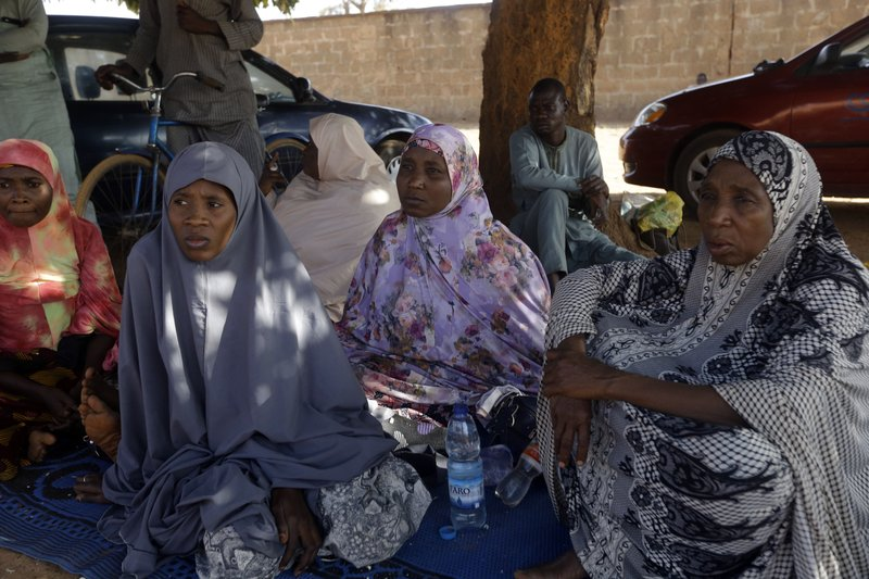 Parents of the missing Government Science secondary school students wait for news on their children in Kankara , Nigeria, Tuesday, Dec. 15, 2020. Rebels from the Boko Haram extremist group claimed responsibility Tuesday for abducting hundreds of boys from a school in Nigeria's northern Katsina State last week in one of the largest such attacks in years, raising fears of a growing wave of violence in the region.