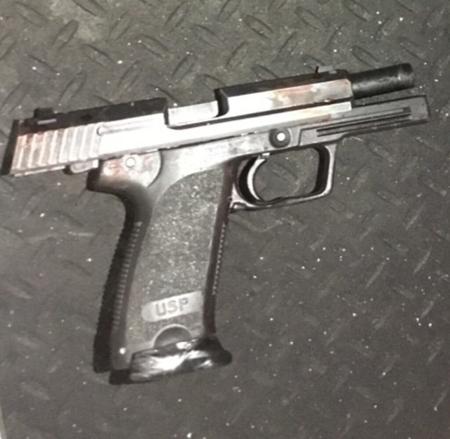 A handgun recovered from the scene of a police shooting in Grande Prairie, Alta. on Tuesday, Dec. 8, 2020.