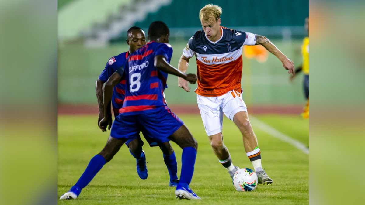 Forge FC Captain Kyle Bekker attempts to allude to players from Haiti's Arcahaie FC in Scotiabank Champions League quarterfinal play Tuesday Dec.1 , 2020.