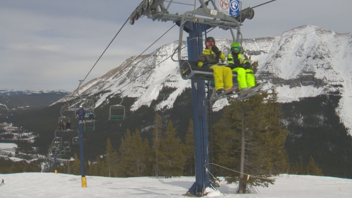 Skiers ride a lift at Castle Mountain Ski Resort in 2019.