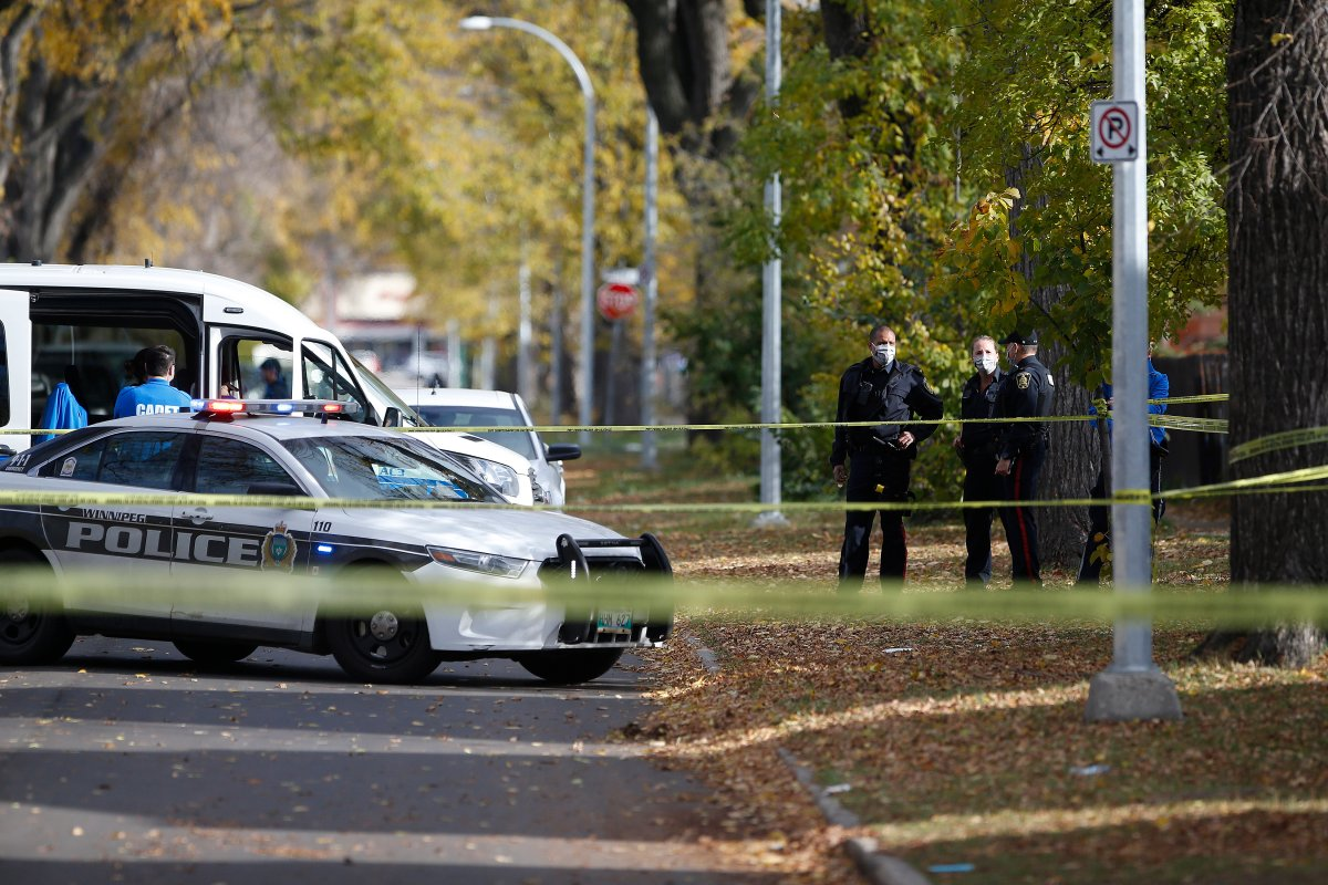Police investigate at the scene of a police shooting in Winnipeg, Wednesday, Oct. 7, 2020.