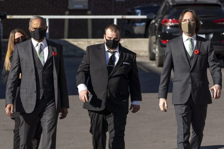 Brayden Bushby, centre, along with his defence team George Joseph, left, and Ryan Green, right, enter the old courthouse ahead of the second day of his manslaughter trial in Thunder Bay, Ont., Tuesday, Nov. 3, 2020. Bushby, 21, threw a trailer hitch at Barbara Kentner, a First Nations woman who died several months after the 2017 assault.