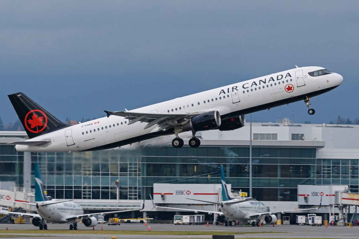 An Air Canada Airbus A321 jet (C-FGKN) takes off from Vancouver International Airport, Richmond, B.C. on Friday, November 20, 2020 on a cross-border flight between Vancouver and Los Angeles.