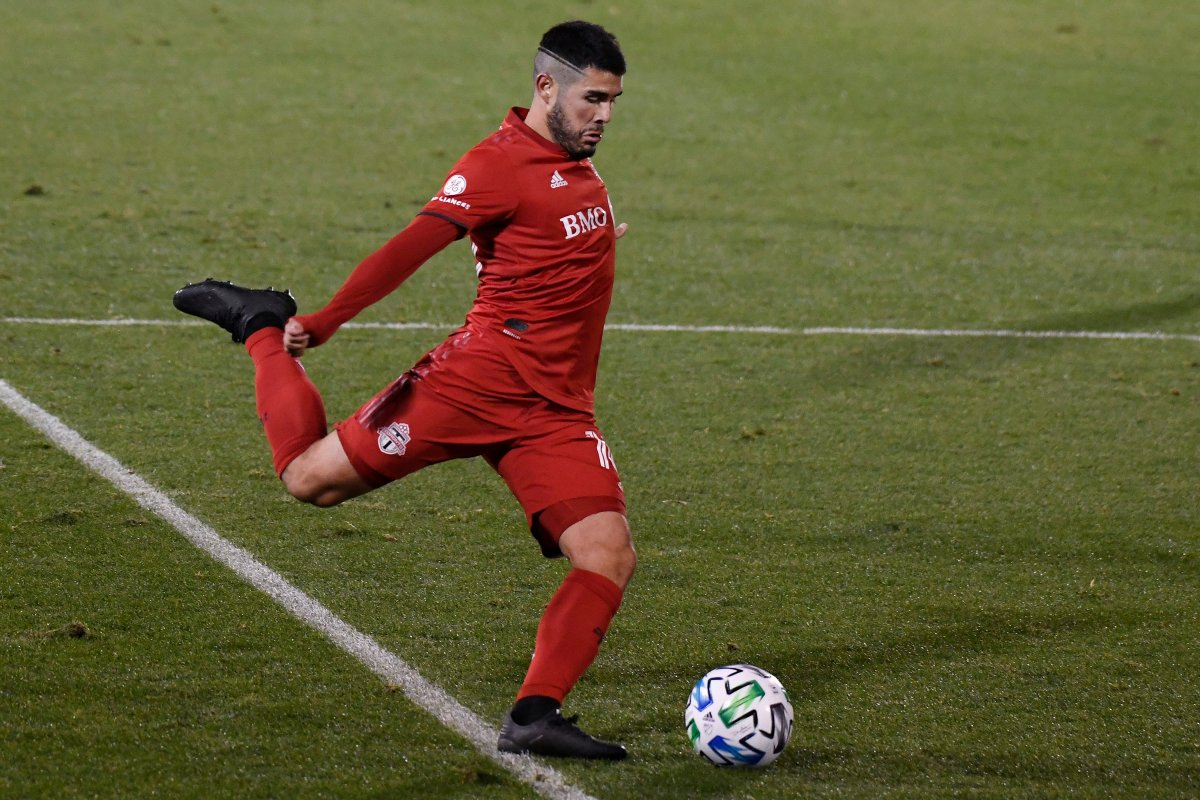 Toronto FC's Alejandro Pozuelo takes a shot on goal during overtime of the team's MLS soccer playoff match against Nashville SC, Tuesday, Nov. 24, 2020, in East Hartford, Conn.