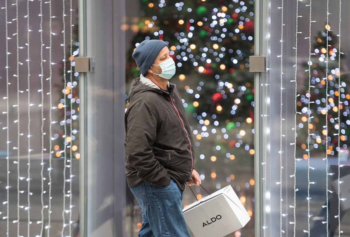 A man walks by festive lights in Montreal, Saturday, Nov. 28, 2020, as the COVID-19 pandemic continues in Canada and around the world.