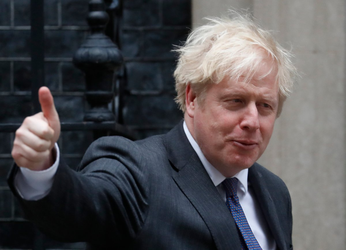 Britain's Prime Minister Boris Johnson shows a thumb up as he welcomes the Crown Prince of the Emirate of Abu Dhabi, Sheikh Mohammed bin Zayed Al Nahyan at 10 Downing Street in London, Thursday, Dec. 10, 2020.