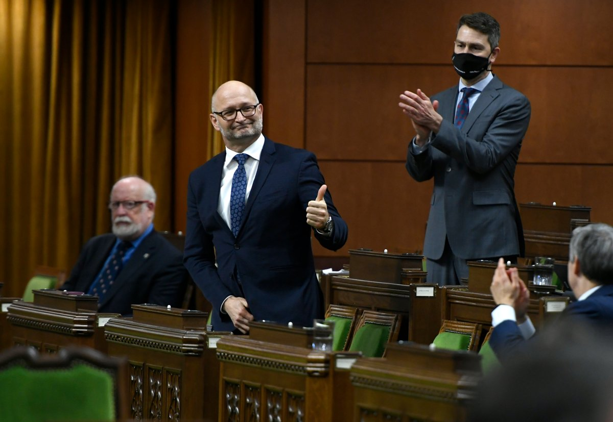 Minister of Justice David Lametti gives a thumbs up as he rises to vote in favour of a motion on Bill C-7, medical assistance in dying, in the House of Commons on Parliament Hill in Ottawa, on Thursday, Dec. 10, 2020.