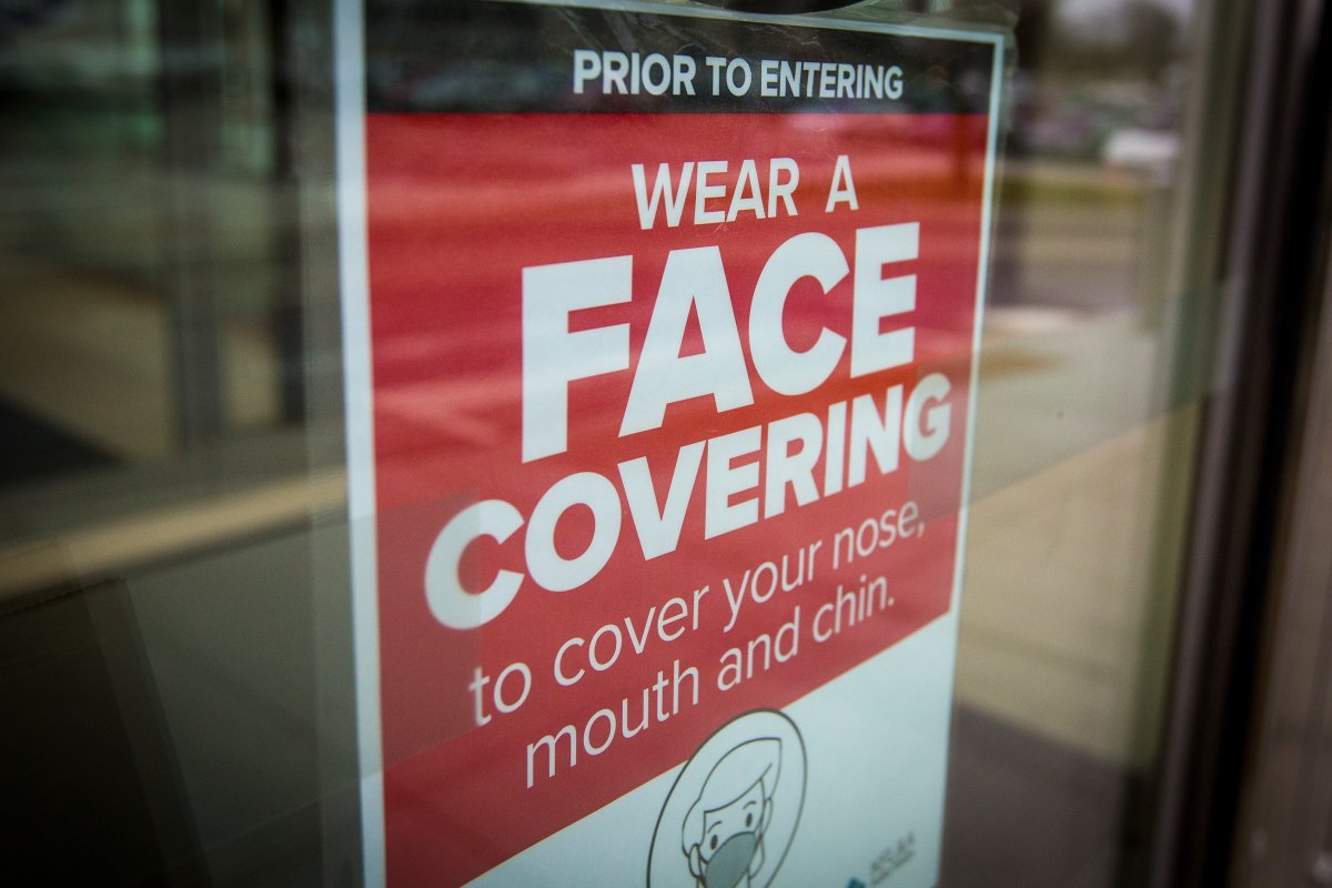 A sign advising to wear a face covering at a shopping centre in Kingston, Ont., on Thursday, Dec. 10, 2020, as the COVID-19 pandemic continues across Canada and around the world.