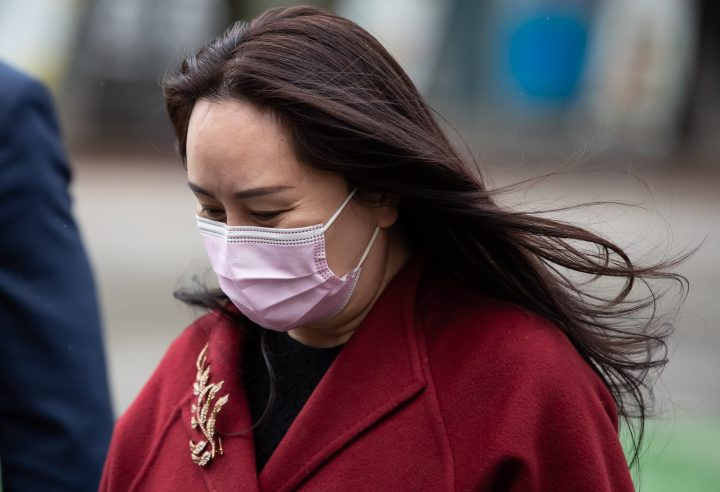 Meng Wanzhou, chief financial officer of Huawei, leaves B.C. Supreme Court during a break from a hearing, in Vancouver, on Friday, December 11, 2020.