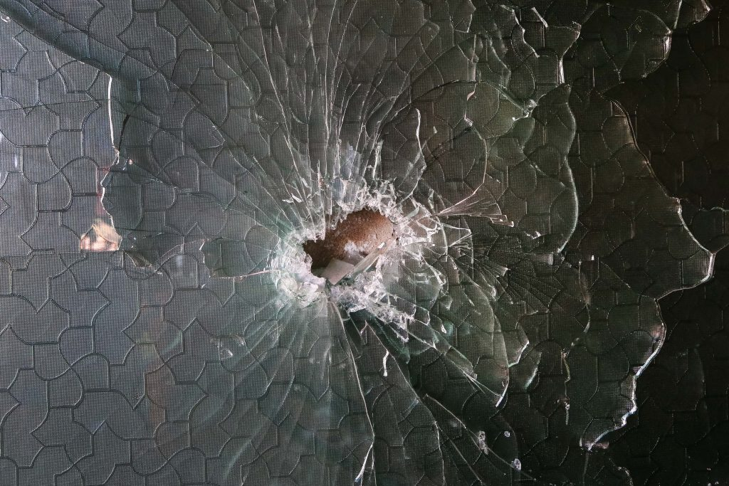 A shrapnel hole in a glass at the site of a rocket attack at a residential house in Kabul, Afghanistan, 12 December 2020.