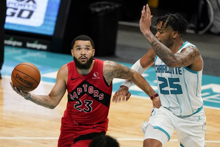 Toronto Raptors guard Fred VanVleet shoots around Charlotte Hornets forward PJ Washington during the first half of an NBA preseason basketball game in Charlotte, N.C., on Saturday, Dec. 12, 2020.