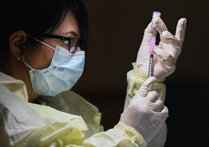 Francesca Passer, a registered pharmacist technician carefully fills the Pfizer-BioNTech COVID-19 mRNA vaccine at a vaccine clinic during the COVID-19 pandemic in Toronto on Tuesday, December 15, 2020. Toronto and Peel region continue to be in lockdown. THE CANADIAN PRESS/Nathan Denette.