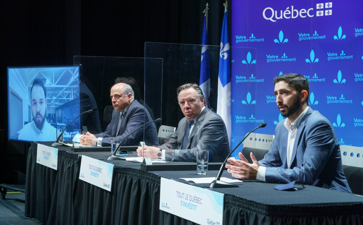 Sonder Canada president Francis Davidson, Quebec Minister of Economy and Innovation Pierre Fitzgibbon, and Quebec Premier François Legault listen to Sonder vice-president Martin Picard, left to right,  during an announcement in Montreal on Wednesday, December 16, 2020.