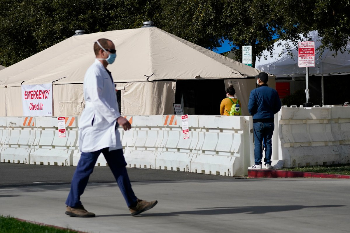 A medical worker passes a medical tent outside the emergency room at UCI Medical Center, Thursday, Dec 17, 2020, in Irvine, Calif.