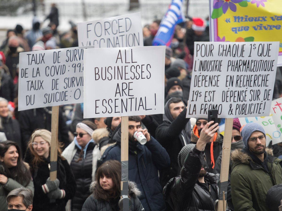 People participate in a demonstration in Montreal, Sunday, December 20, 2020, protesting measures implemented by the Quebec government to help stop the spread of COVID-19. The COVID-19 pandemic continues in Canada and around the world.