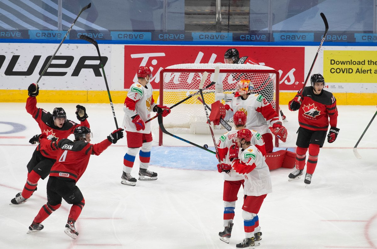 Canada's Bowen Byram (4), Connor McMichael (17) and Peyton Krebs (18) celebrate a goal against Russia's goalie Artur Akhtyamov (29) during third period IIHF World Junior Hockey Championship pre-competition action in Edmonton on Wednesday, December 23, 2020.