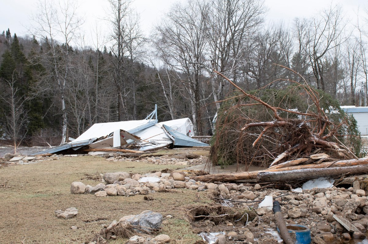 A ruined clubhouse is seen on the campground, in Sainte-Brigitte-de-Laval, Que., Saturday, Dec. 26, 2020. A flash flood forced the evacuation of residents on Christmas day, Dec. 25, as the waters of the Montmorency river came up because of heavy rains.