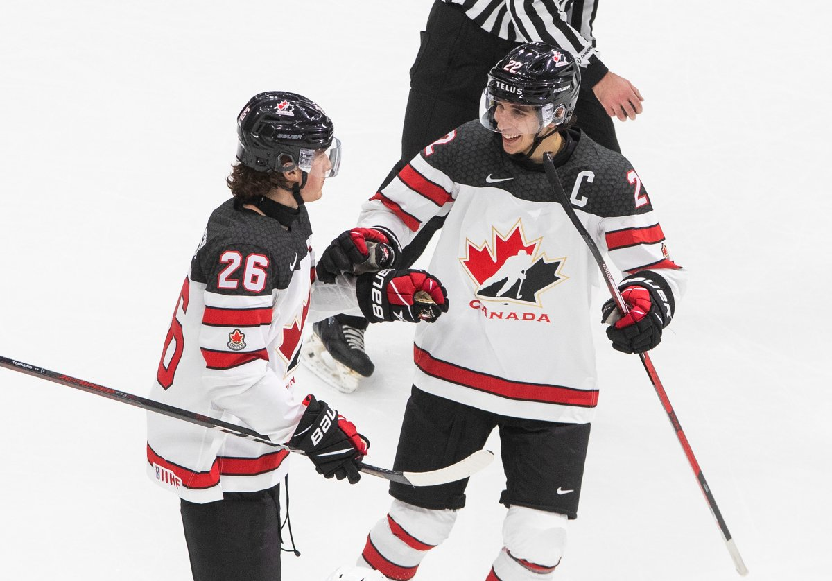 Canada's Philip Tomasino (26) celebrates his goal with teammate Dylan Cozens against Slovakia during third period IIHF World Junior Hockey Championship action in Edmonton on Sunday, December 27, 2020.
