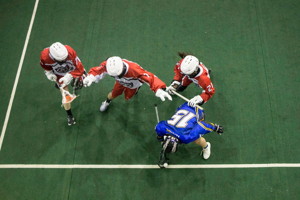 File photo - British Columbia's Mattea Shima (15) holds off Ontario defenders during women's lacrosse action at the North American Indigenous Games in Hagerville, Ontario, on Monday, July 17, 2017.