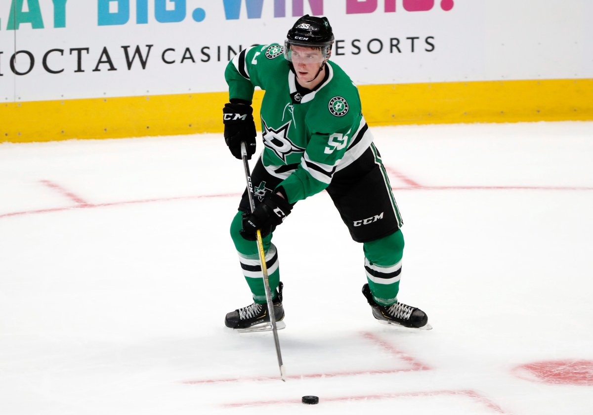 Dallas Stars defenseman Thomas Harley (55) handles the puck in the third period of a preseason NHL hockey game against the St. Louis Blues in Dallas, Monday, Sept. 16, 2019.