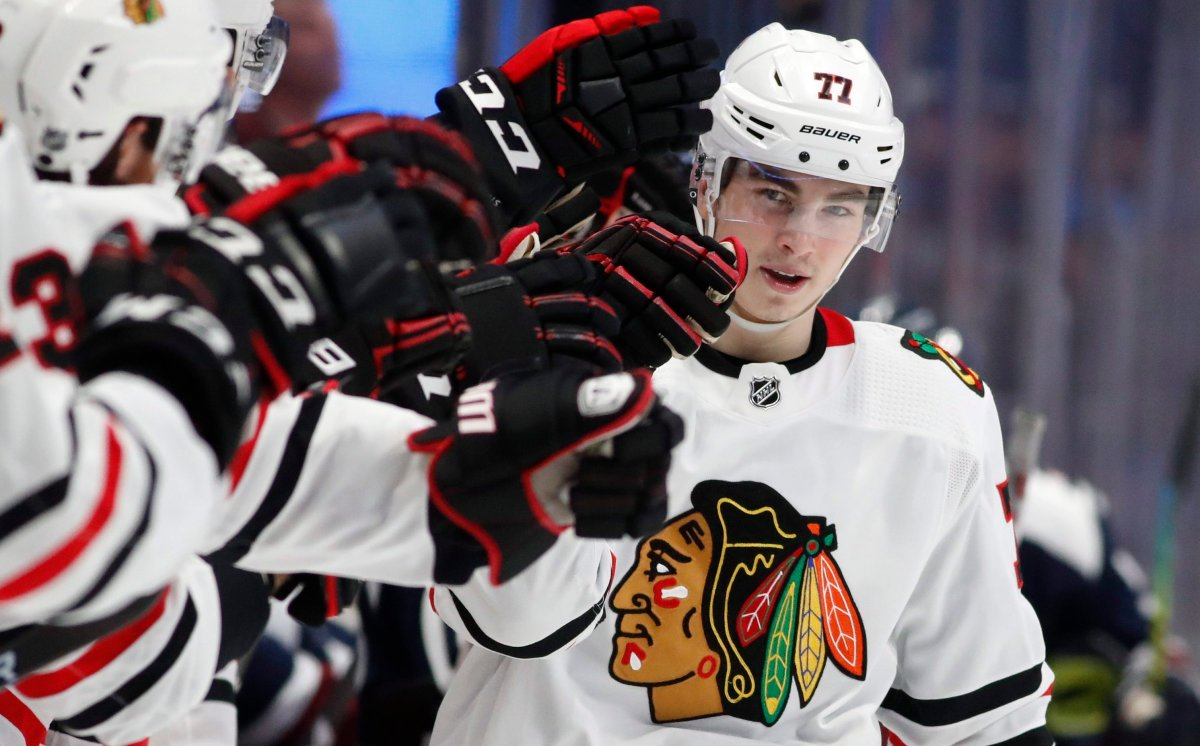 Chicago Blackhawks center Kirby Dach is congratulated as he passes the team box after scoring the tying goal against the Colorado Avalanche during the third period of an NHL hockey game Saturday, Dec. 21, 2019, in Denver. Chicago won 5-3.