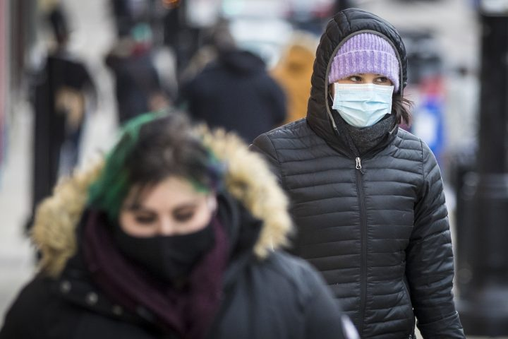 A person wears a disposable mask in Kingston, Ontario on Wednesday, December 16, 2020, as the COVID-19 pandemic continues across Canada and around the world.