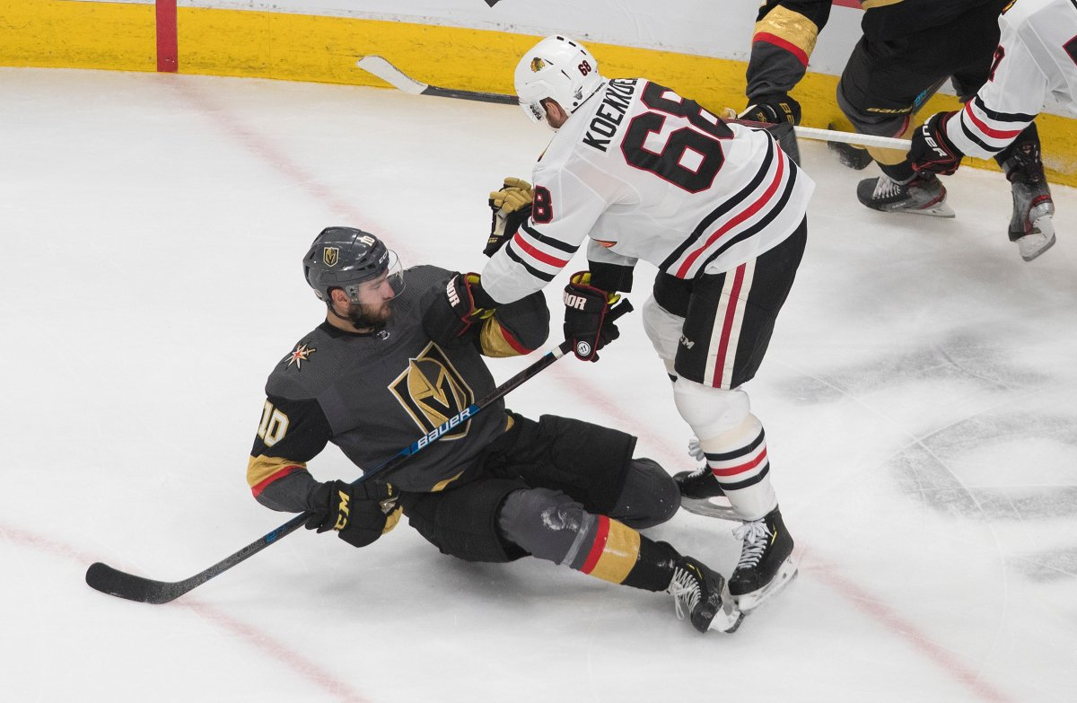 Chicago Blackhawks' Slater Koekkoek (68) checks Vegas Golden Knights' Nicolas Roy (10)during the second period of a first round NHL Stanley Cup playoff hockey series in Edmonton, on Tuesday August 11, 2020. THE CANADIAN PRESS/Jason Franson.