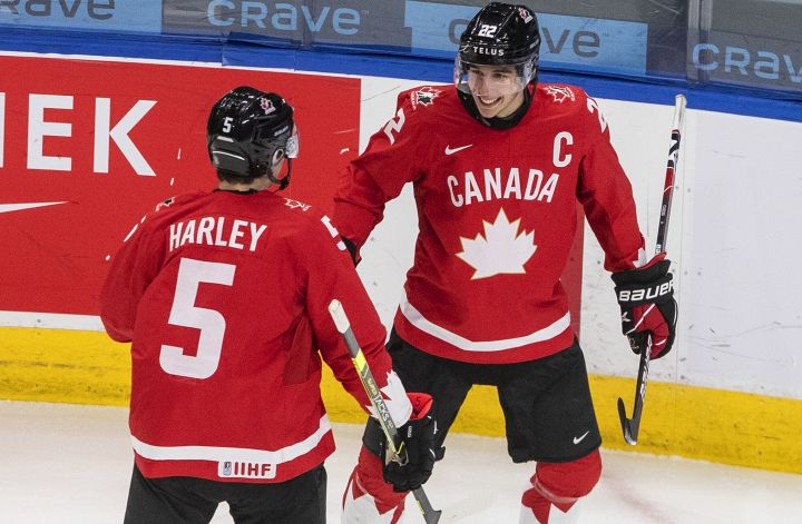 Canada's Thomas Harley (5) and Dylan Cozens (22) celebrate a goal during first period IIHF World Junior Hockey Championship action against Finland, in Edmonton, Thursday, Dec. 31, 2020.
