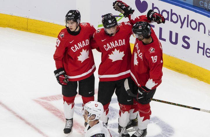 Canada's Jack Quinn (29), Ryan Suzuki (16) and Quinton Byfield (19) celebrate a goal against Switzerland during second period IIHF World Junior Hockey Championship action in Edmonton on Tuesday, December 29, 2020.