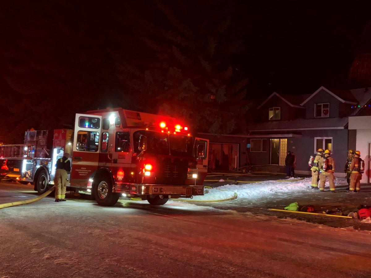 Crews respond to a house fire in Calgary Tuesday, Dec. 15, 2020.