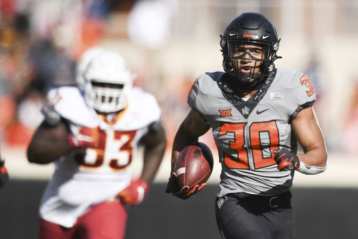 Chuba Hubbard (30) scores a touchdown during the first half of an NCAA college football game against Iowa State Saturday, Oct. 24, 2020, in Stillwater, Okla.