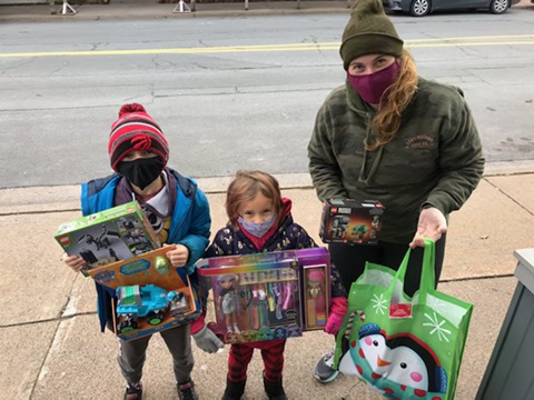 Image of Jessica Salmon with her niece and nephew, donating $300 worth of toys and goods for the shelter.