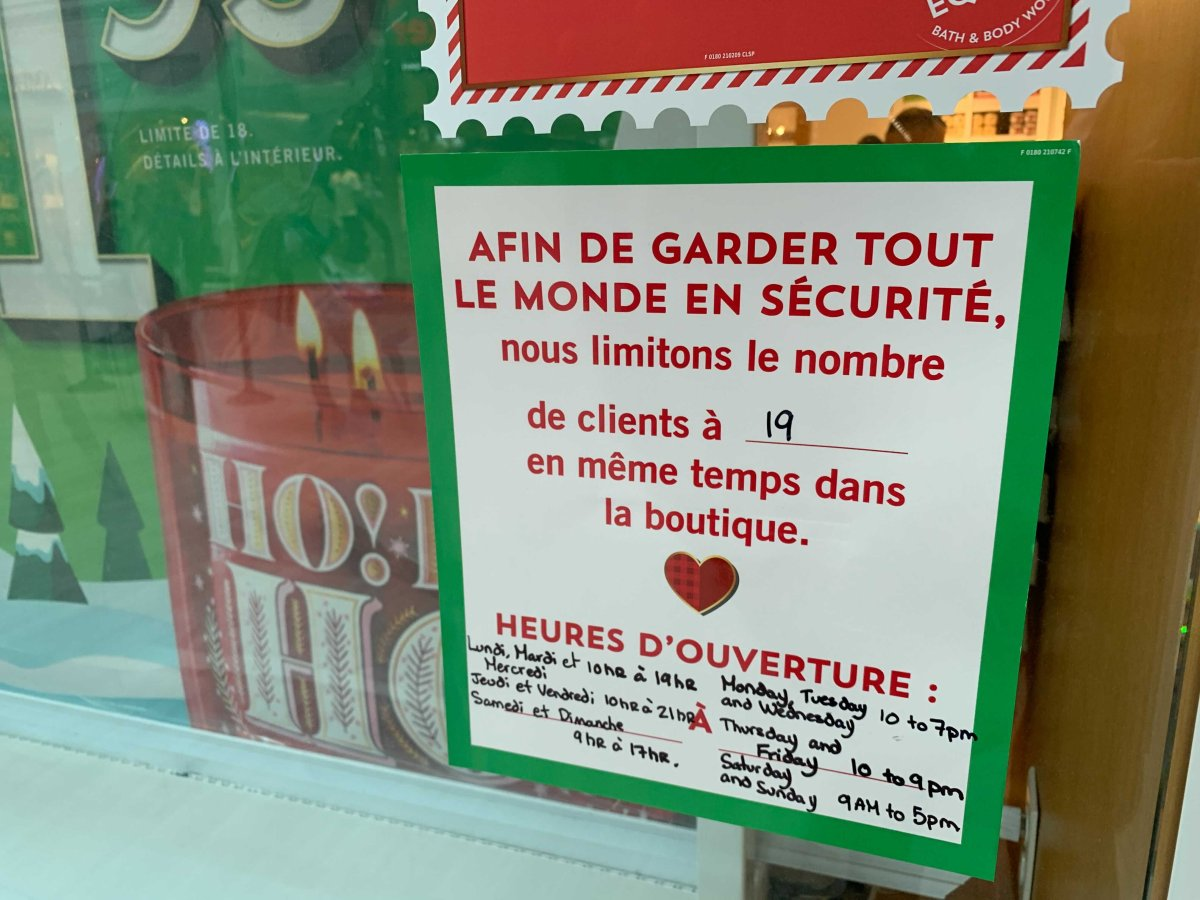 A store at Fairview Mall in Pointe-Claire, Que. lists its maximum number of clients allowed at a time during the COVID-19 pandemic.