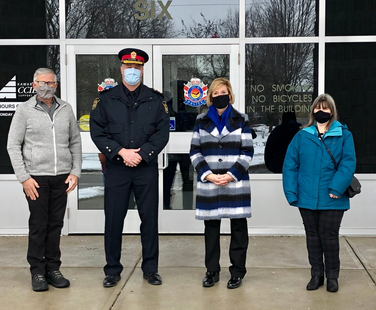From left, Don Thomas, chair of the City of Kawartha Lakes Police Services Board, police chief Mark Mitchell, MPP Laurie Scott and Hope Lee, CEO of the KLH Housing Corp., pose for a photo after an announcement of funding for CCTV cameras.