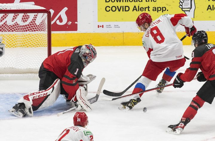 Canada's goalie Devon Levi (1) makes the save on Russia's Arseni Gritsyuk (8) during second period IIHF World Junior Hockey Championship pre-competition action in Edmonton on Wednesday, December 23, 2020.