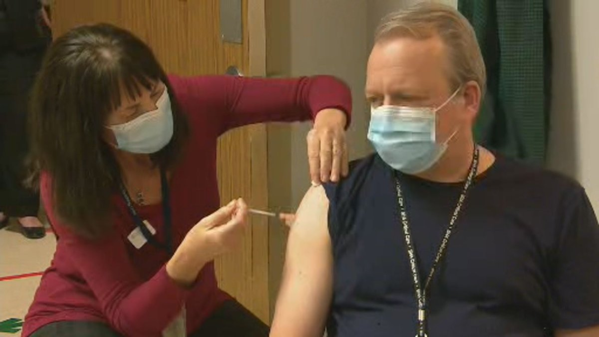 Dr. Jeffrey Betcher was the first person in Saskatchewan to be vaccinated.