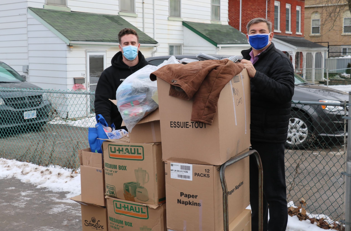 The Spread the Warmth campaign collected several thousand articles of clothing for shelters  in Peterborough, says MPP Dave Smith, right.