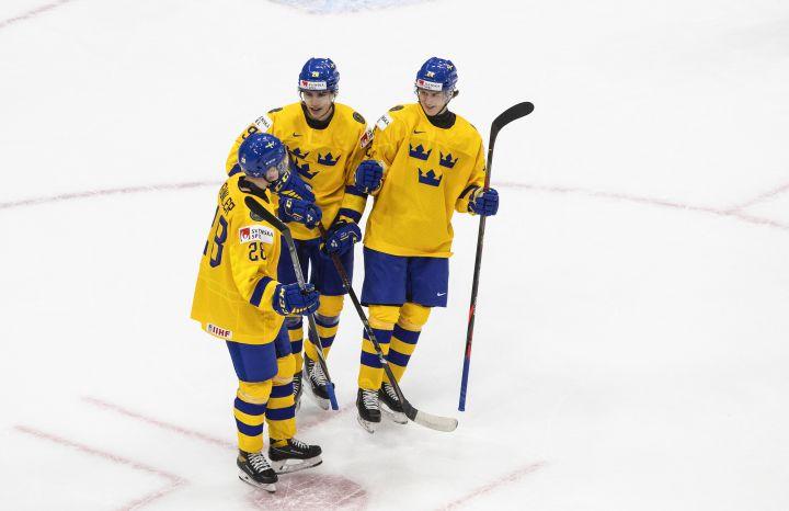 Sweden's Noel Gunler (28), Albin Sundsvik (29) and Oskar Olausson (24) celebrate a goal against Austria during first period IIHF World Junior Hockey Championship action in Edmonton on Monday, December 28, 2020.