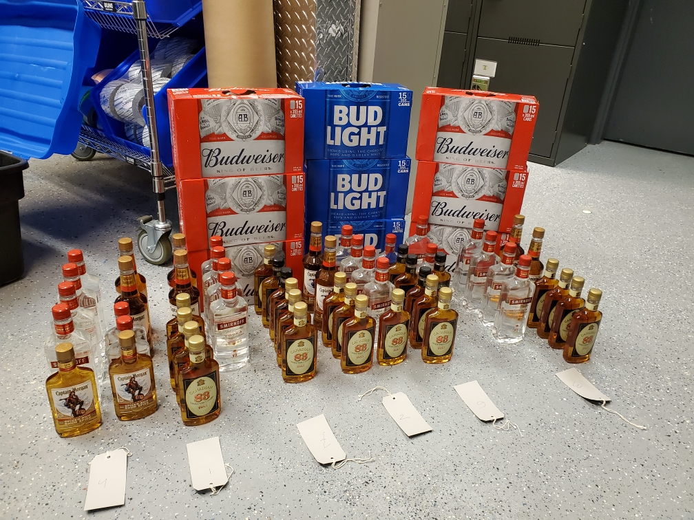 Manitoba RCMP say they seized dozens of bottles of hard liquor and several cases of beer that were allegedly being bought legally and sold at a markup in Thompson.