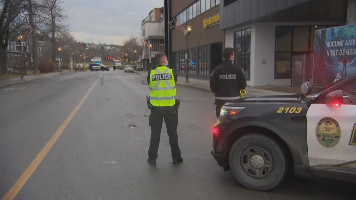 Police in Saguenay have put up a safety perimetre encompassing a large section of Racine Street after a suspicious package was discovered Friday afternoon near a building housing Ubisoft offices. Dec. 4, 2020.