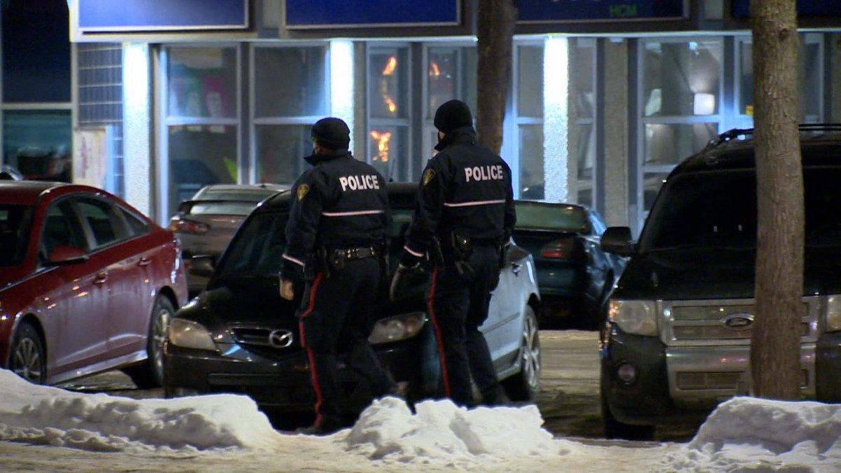Police officers walking through downtown Saskatoon.