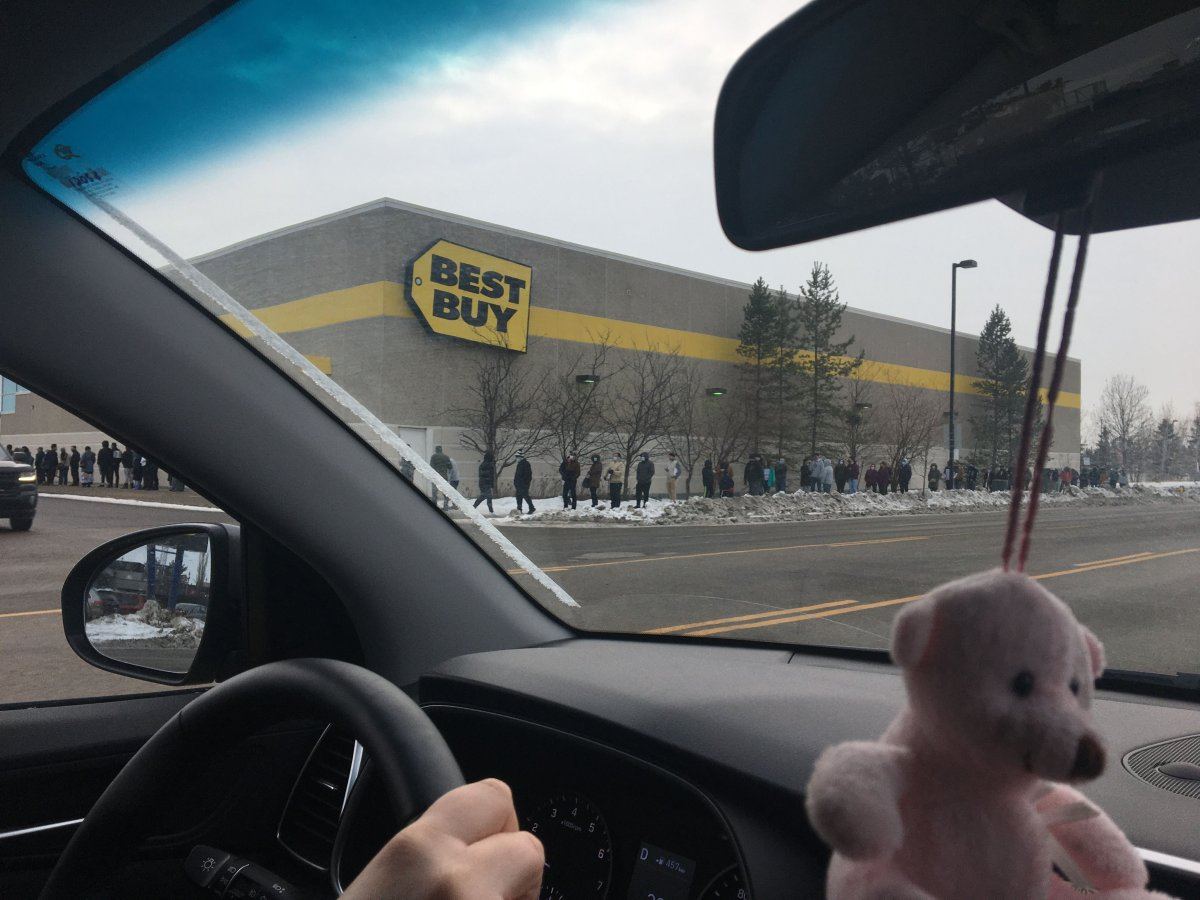Shoppers wait outside the South Edmonton Common Best Buy on Boxing Day, Dec. 26, 2020.
