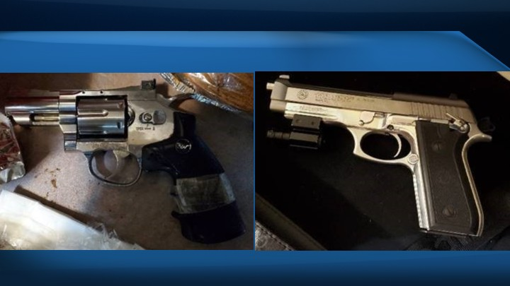 Officers say they seized two handguns, one of which was loaded.